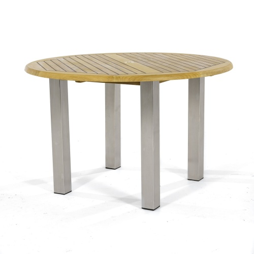 teak round stainless steel dining table indoor
