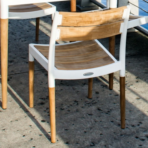 stacking cast aluminum and teak chairs